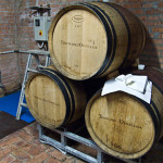 Ornellaia red wine barrels