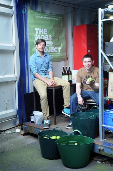 THE MOSS CIDER PROJECT, MANCHESTER. FOUNDER DAN HASLER, 32, AND DIRECTOR JOE WEEKS, 40 , AT THE OLD SHIPPING CONTAINER IN MOSS SIDE WHERE THEY PRESS THE APPLES. PHOTO BY CLARE KENDALL.